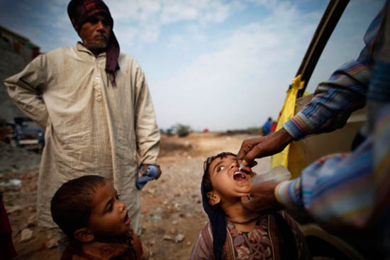 A child is administered polio drops during an antipolio drive in New Delhi on Jan. 15, 2012